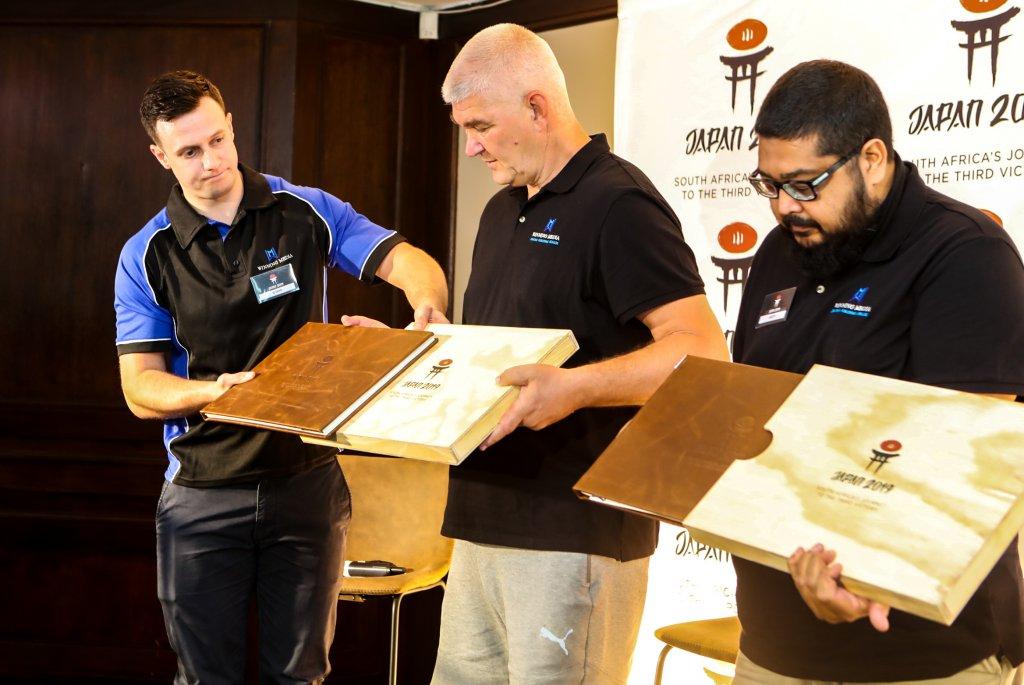 Gareth Jenkinson handing over photobooks to Steve Haag and Anesh Debiky
